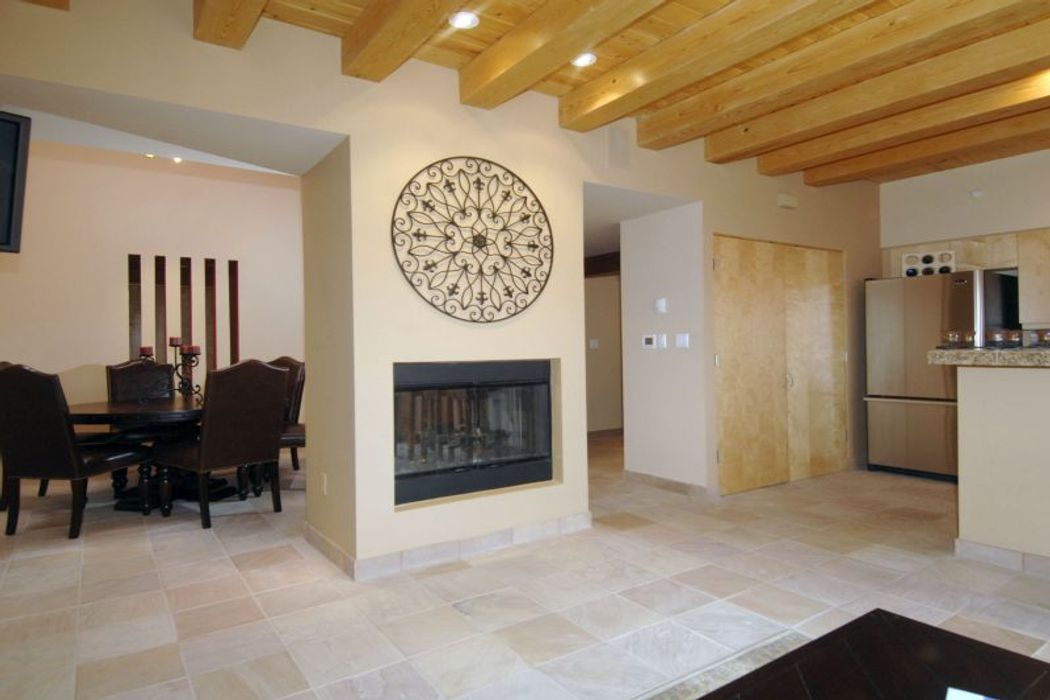 Two-way fireplace open to Dining and living areas