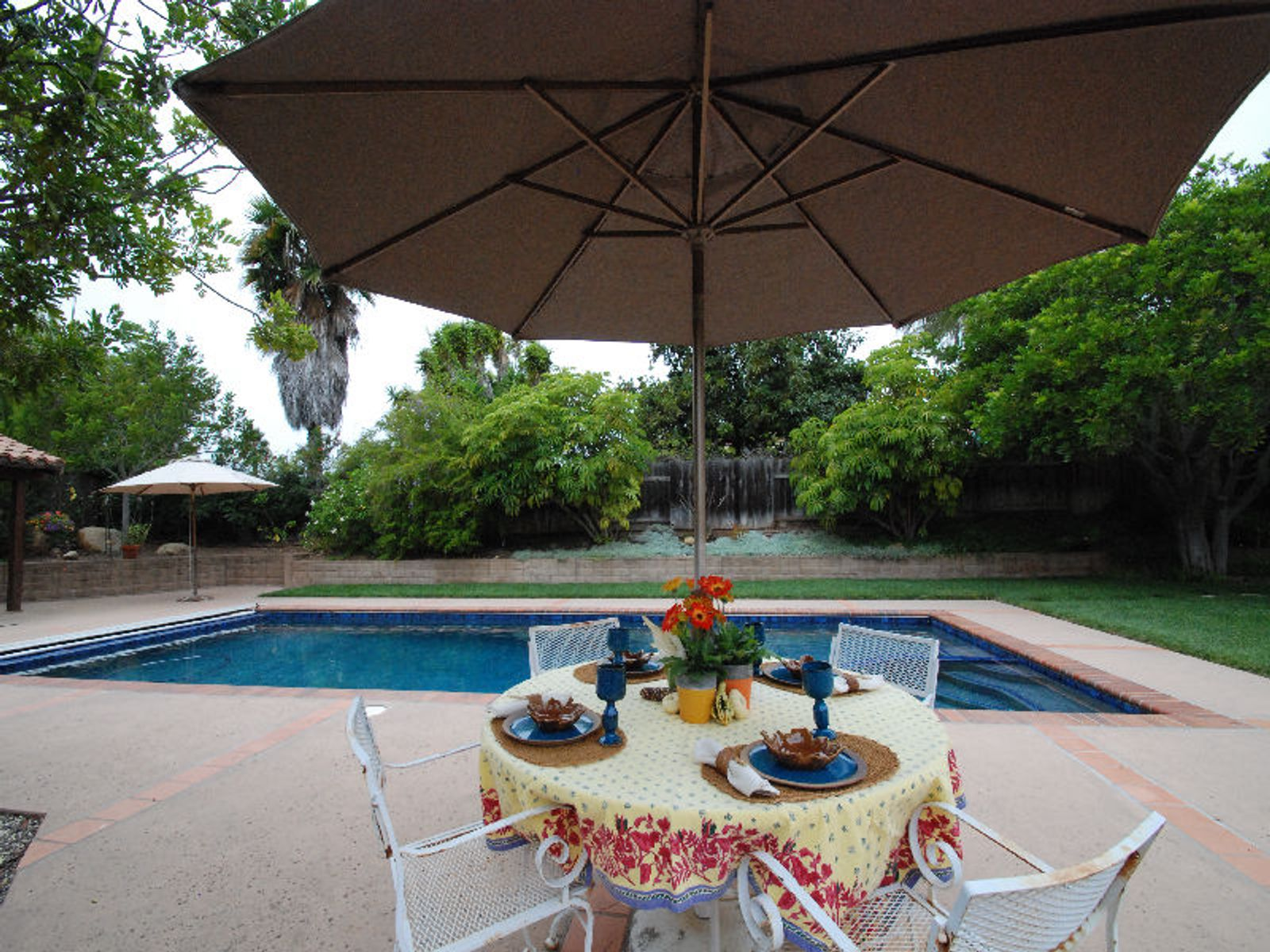 Patio Dining with View of Pool and Back Yard