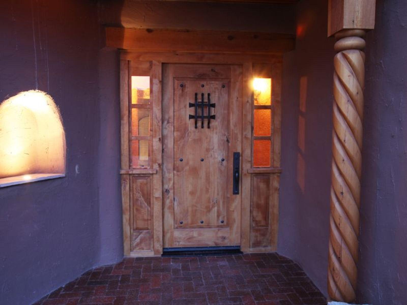 Main House:  Custom carved entry door