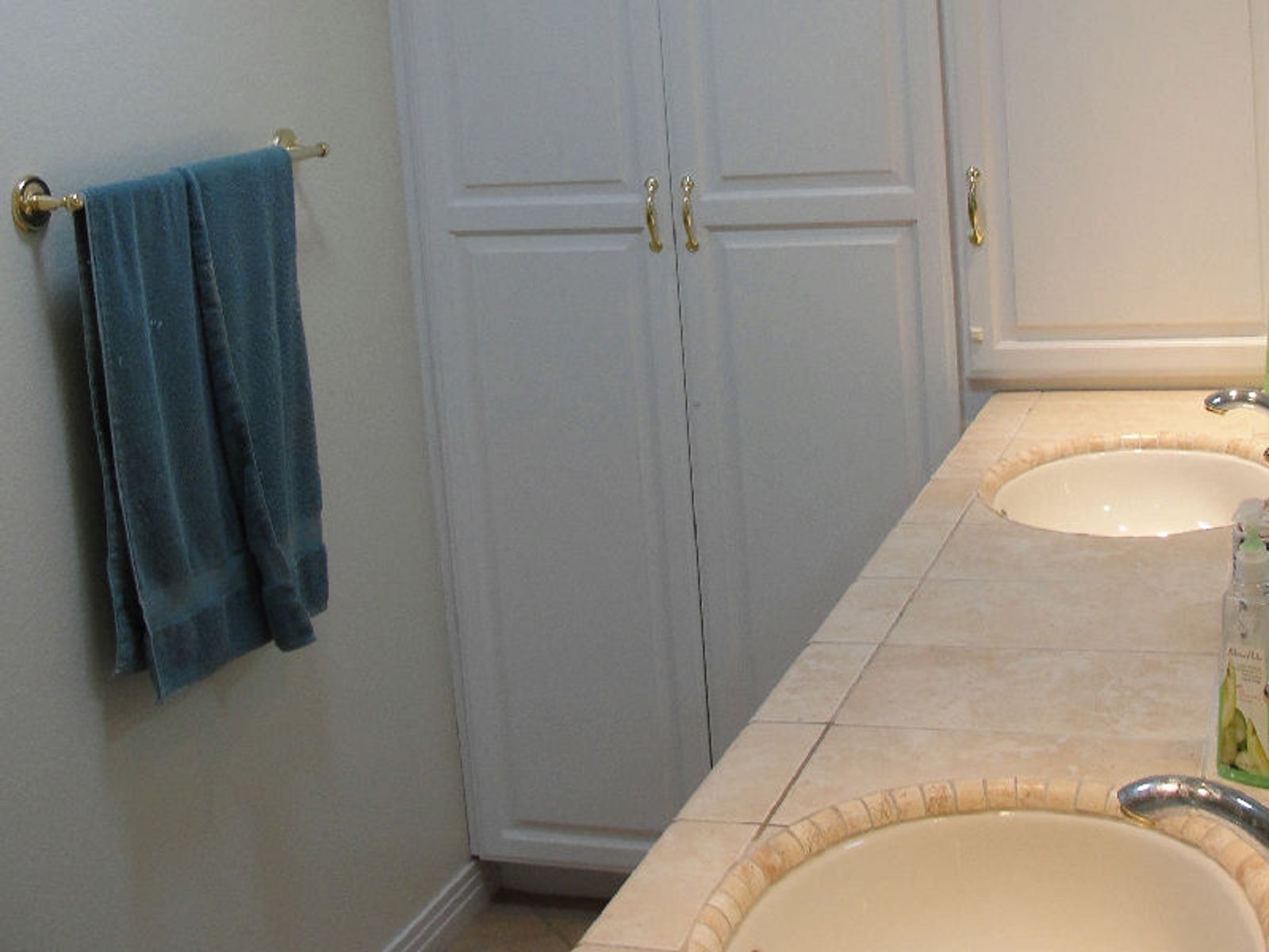 Master bath with double sinks and linen closet.