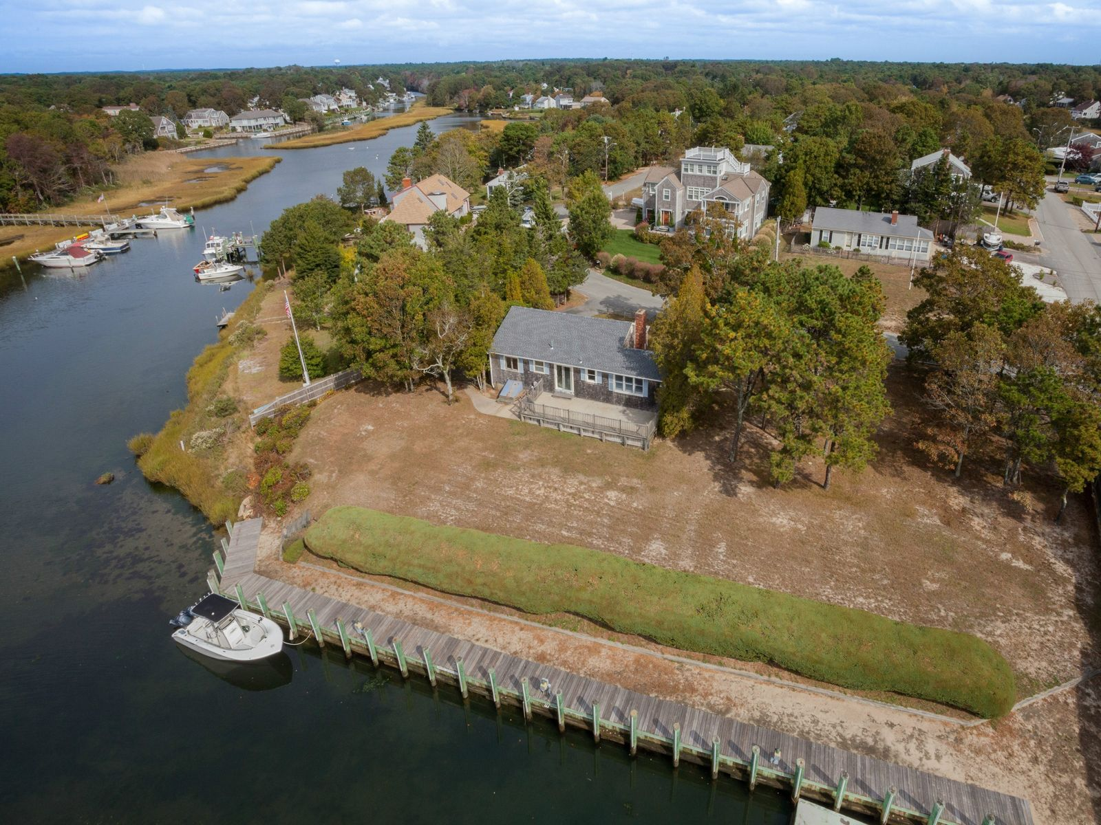 Waterfront Cottage with Deep Water Dock, East Falmouth MA Single Family Home - Cape Cod Real Estate
