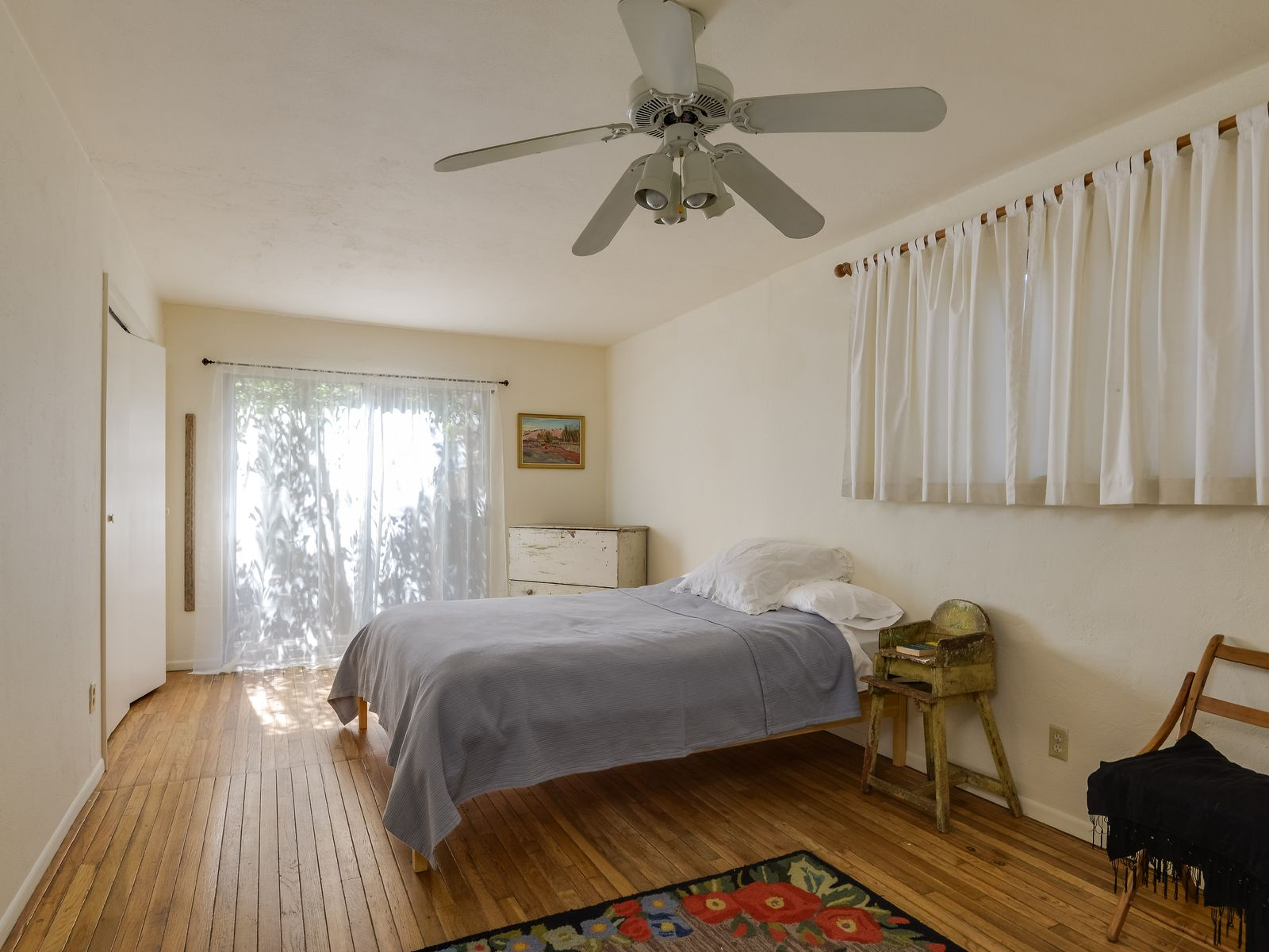 huge sunny master bedroom with two closets