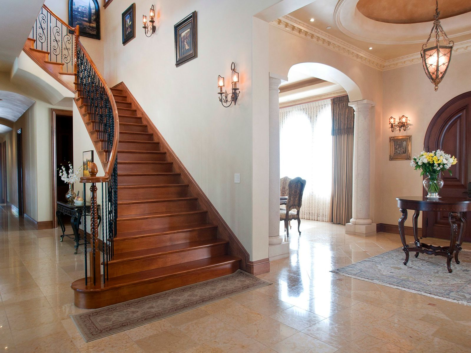 Sweeping custom staircase of maple  & wrought iron