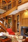 Two story custom library equipped with an elevator