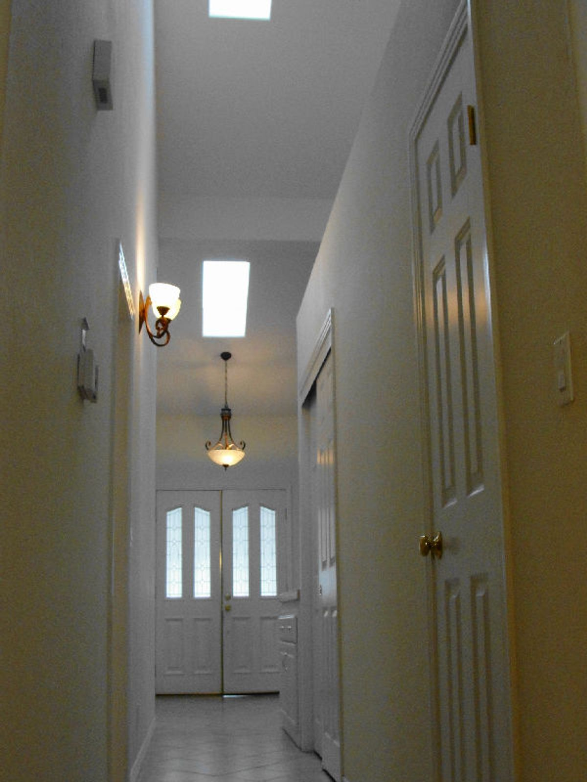 Skylight, tile floors and double front entry doors
