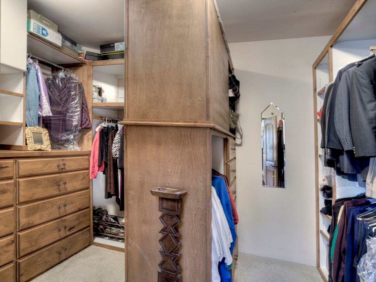 Well-lit master closet with his and her bays