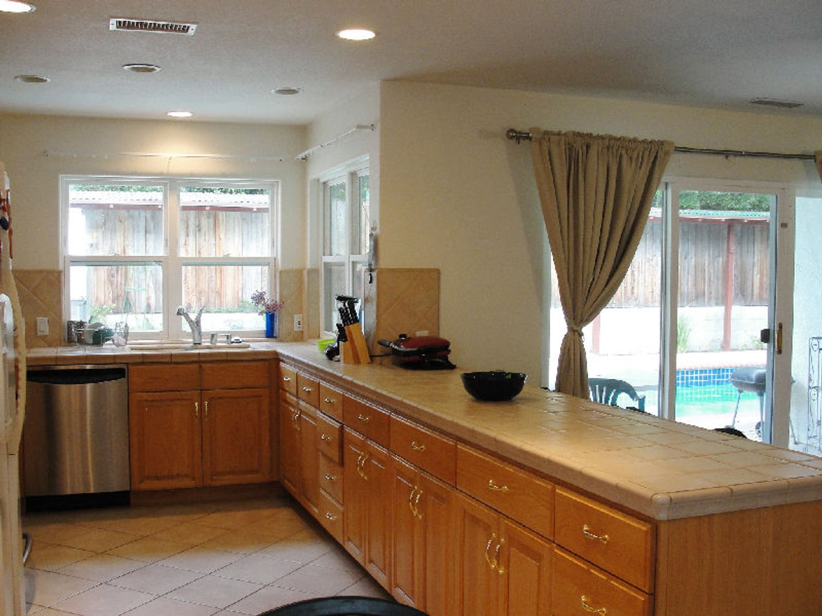 Gourmet kitchen with dinette and custom cabinetry.