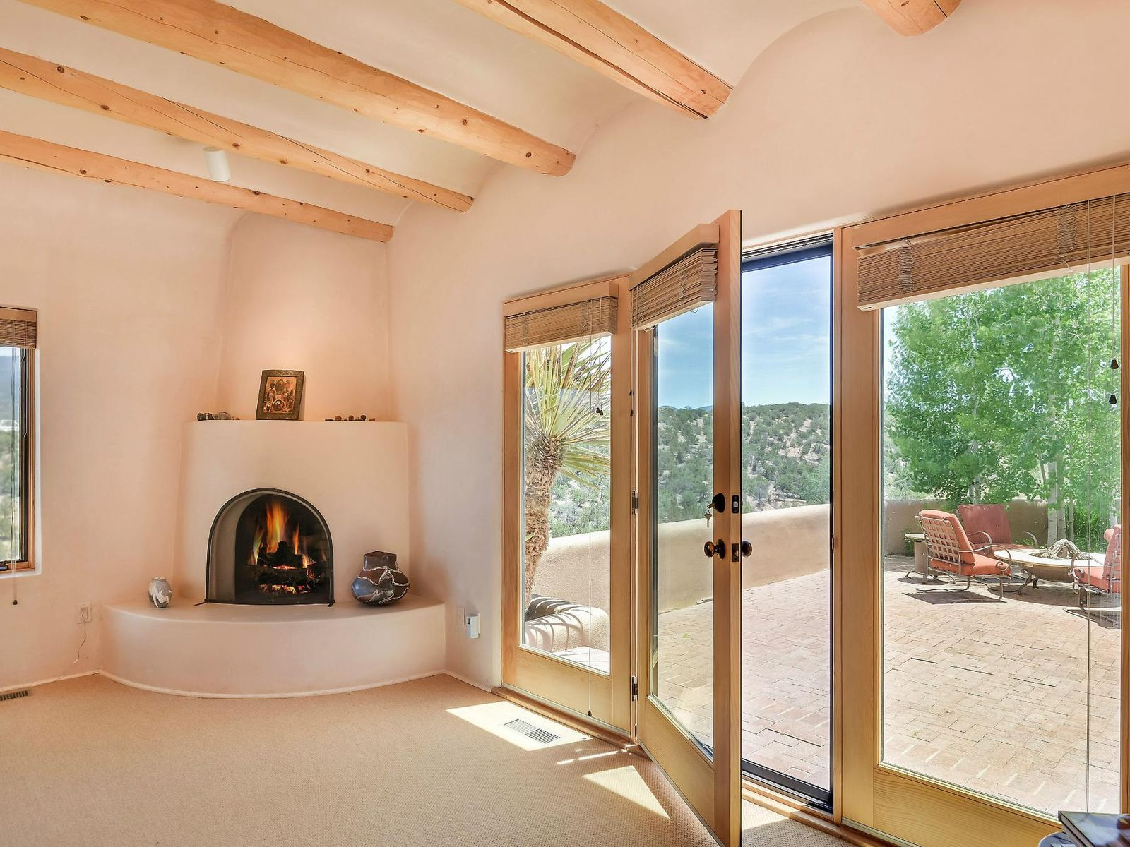 Master Kiva Fireplace & French Doors to Terrace