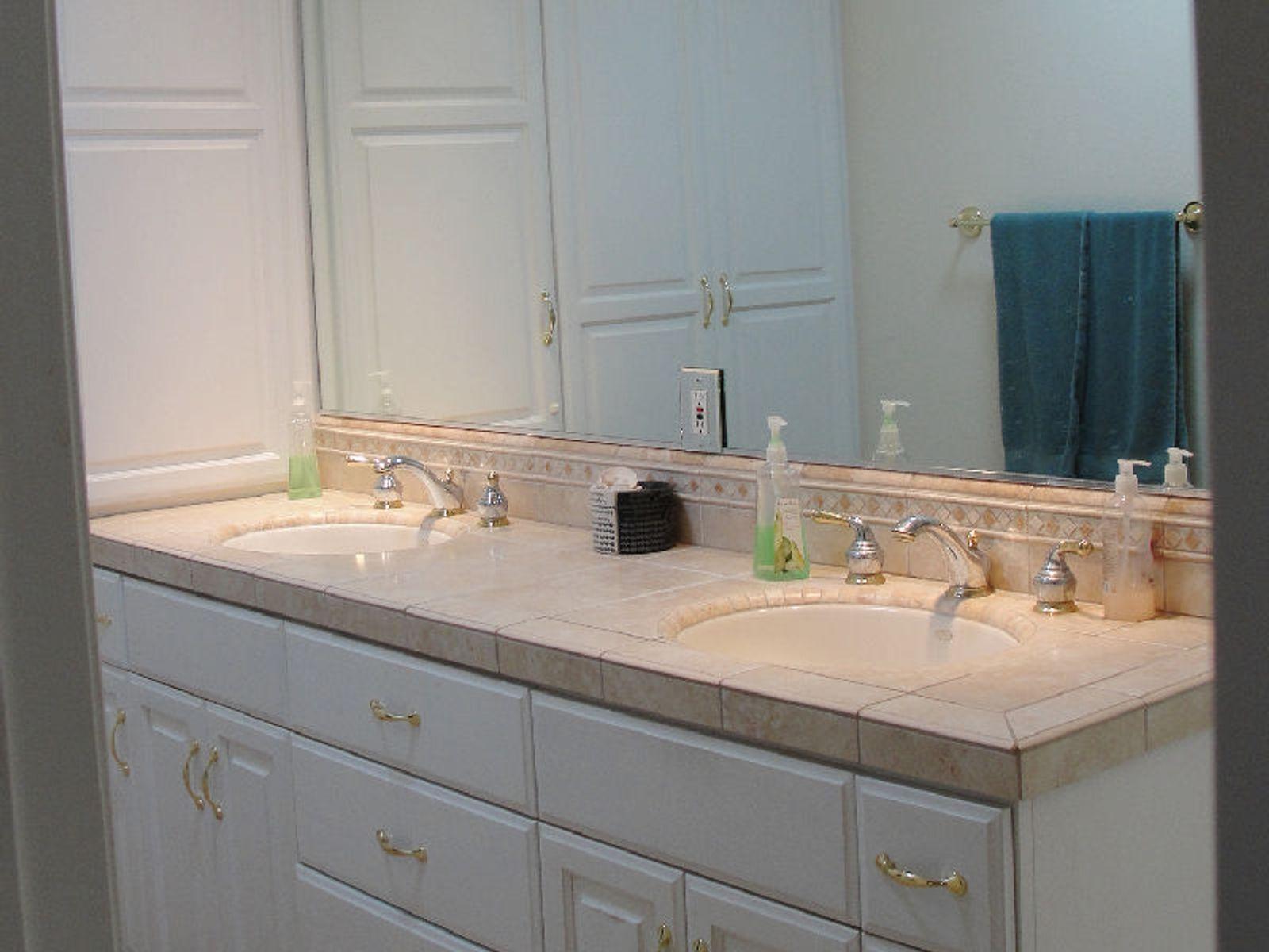 Master bath with designer, hand-set ceramic tile.