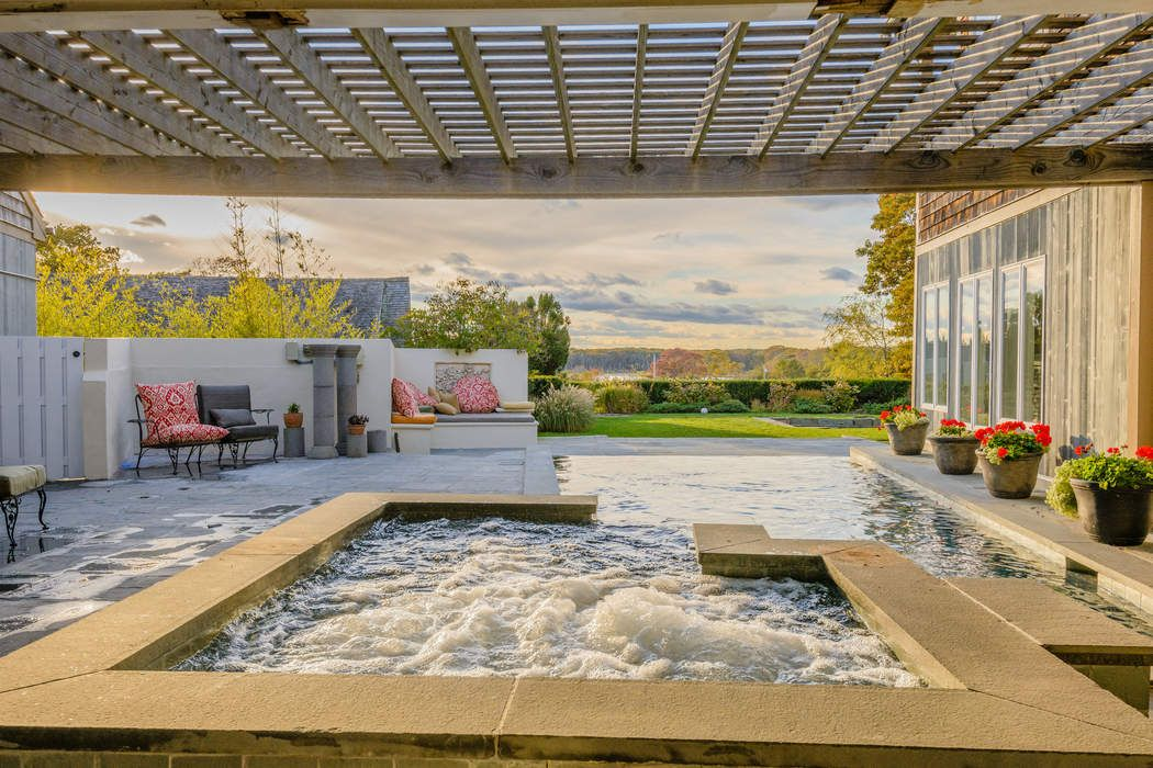 POST MODERN WITH INFINITY POOL AND POND  Sagaponack, NY 11962