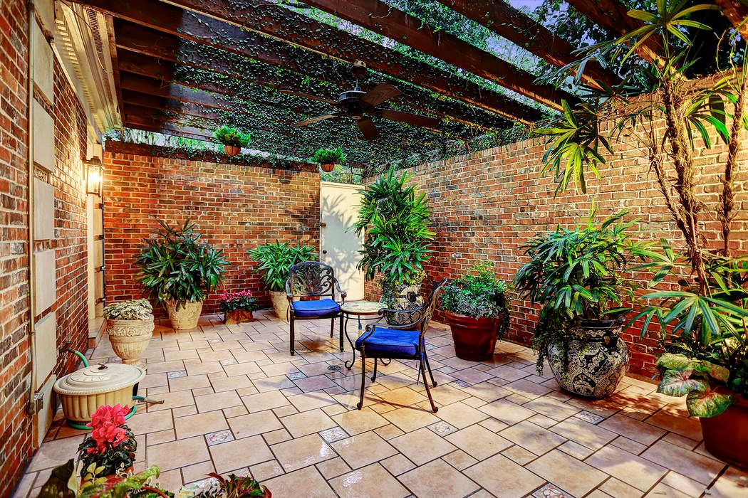 This Private Patio Is Located Just Outside The Master Bedroom And Is  Accessible Through French Doors. Brick Walls Surrounding The Private Patio  With Pergola ...