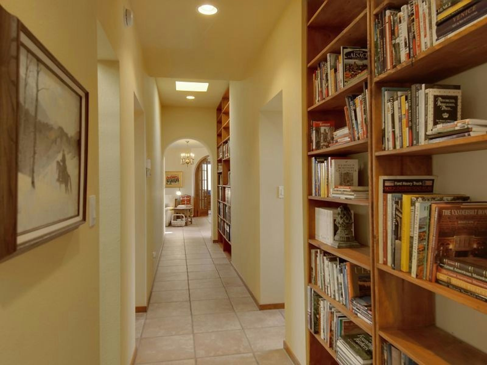 Hall lined with built-in bookshelves