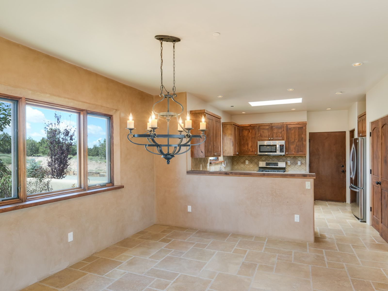 View from living to front entry and dining area