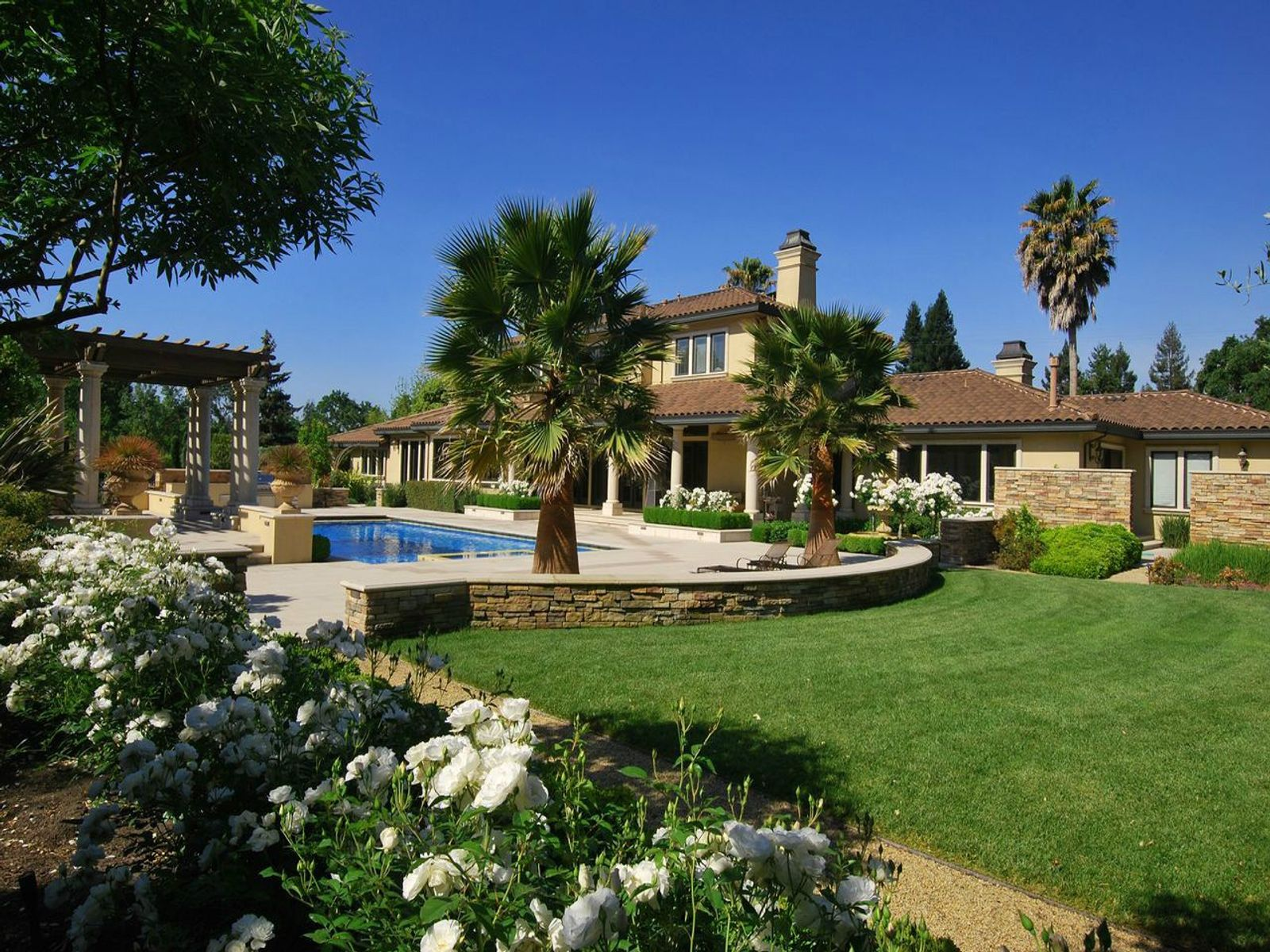 Approx 1.21 acres of lawn, gardens, swimming pool