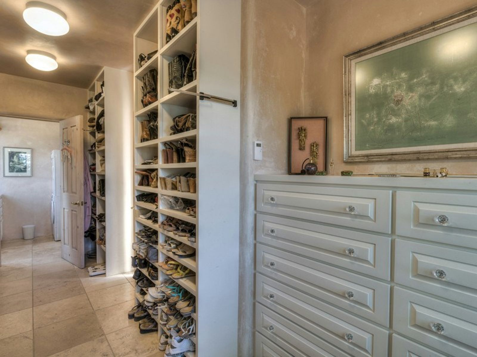 Her Closet with Laundry Room