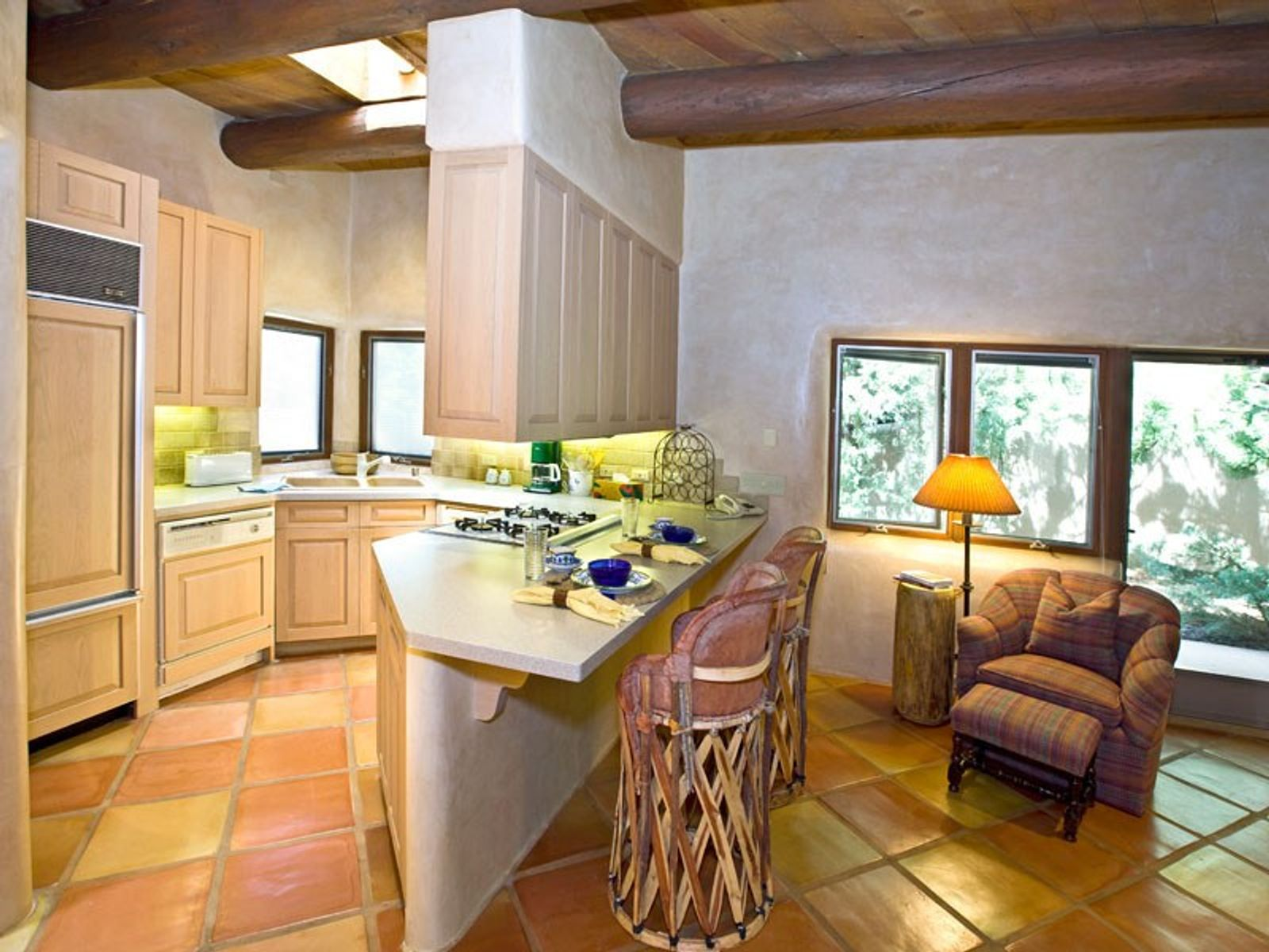 The kitchen includes full-size appliances...
