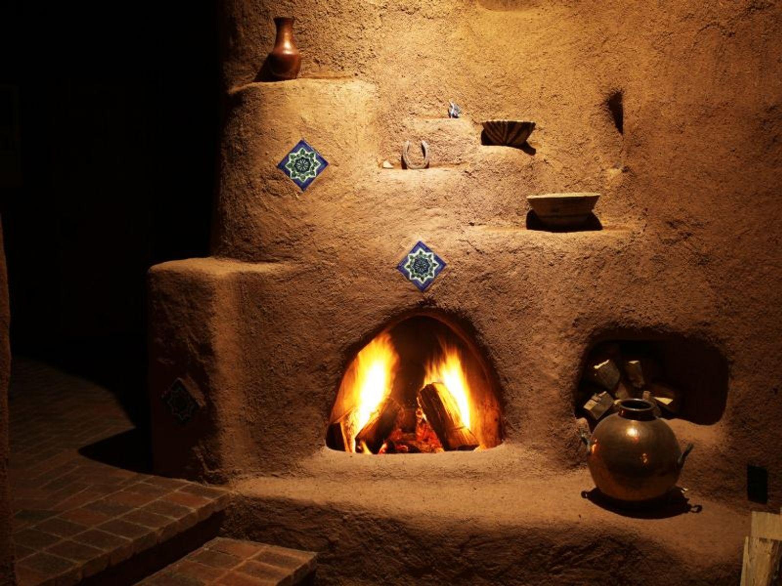 Main House: Massive Adobe Kiva Fireplace