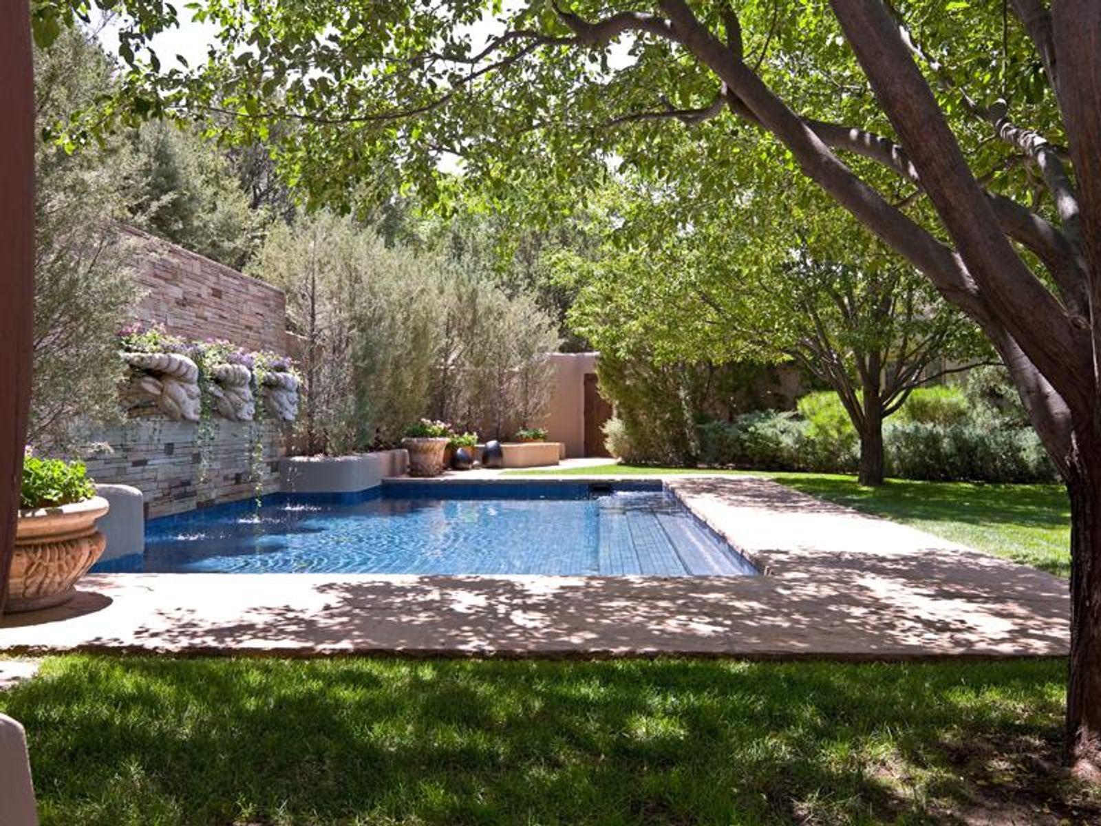 Idyllic backyard, w/lush swath of lawn, pool & hot