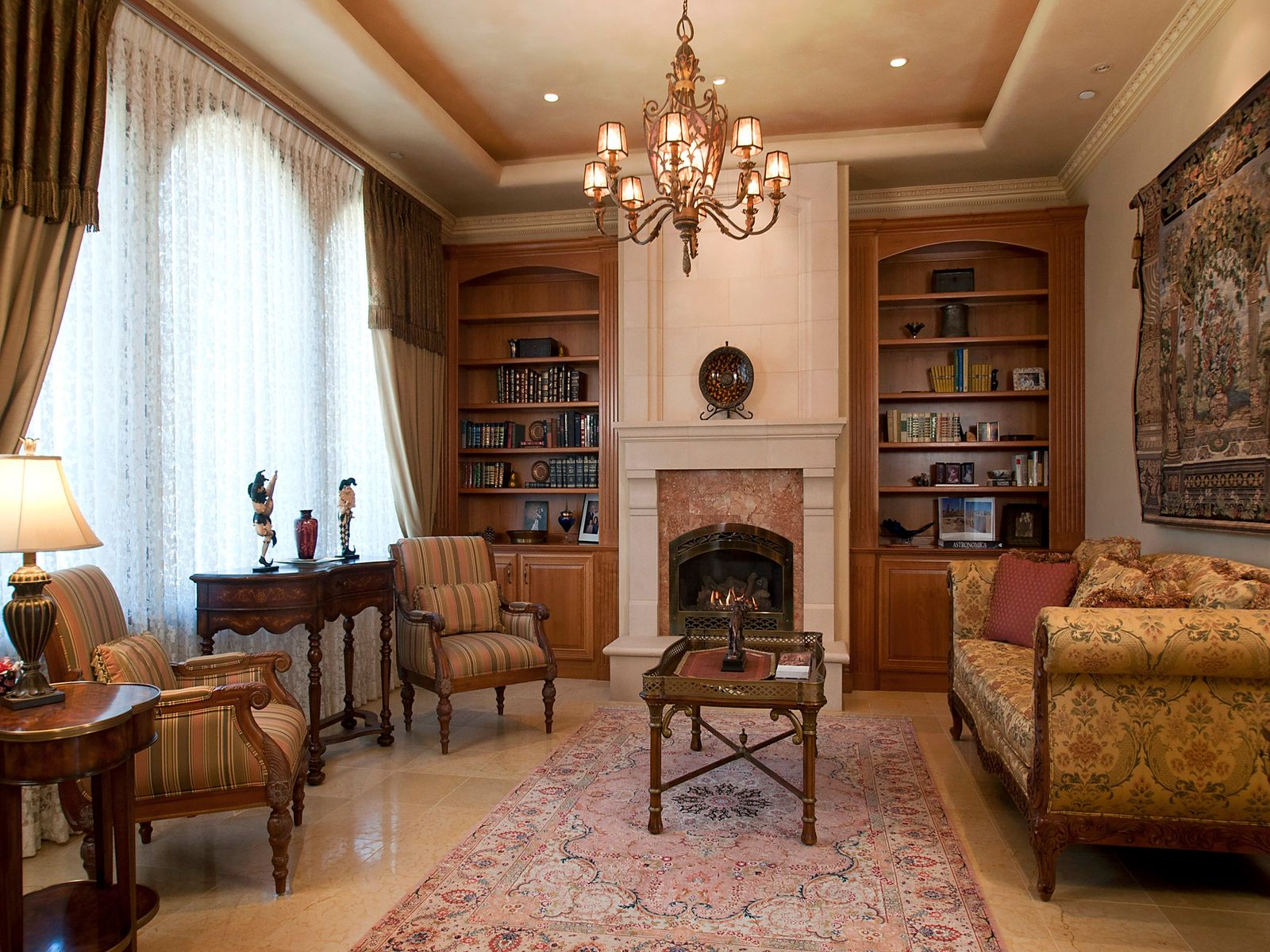 Formal living features graceful arched windows