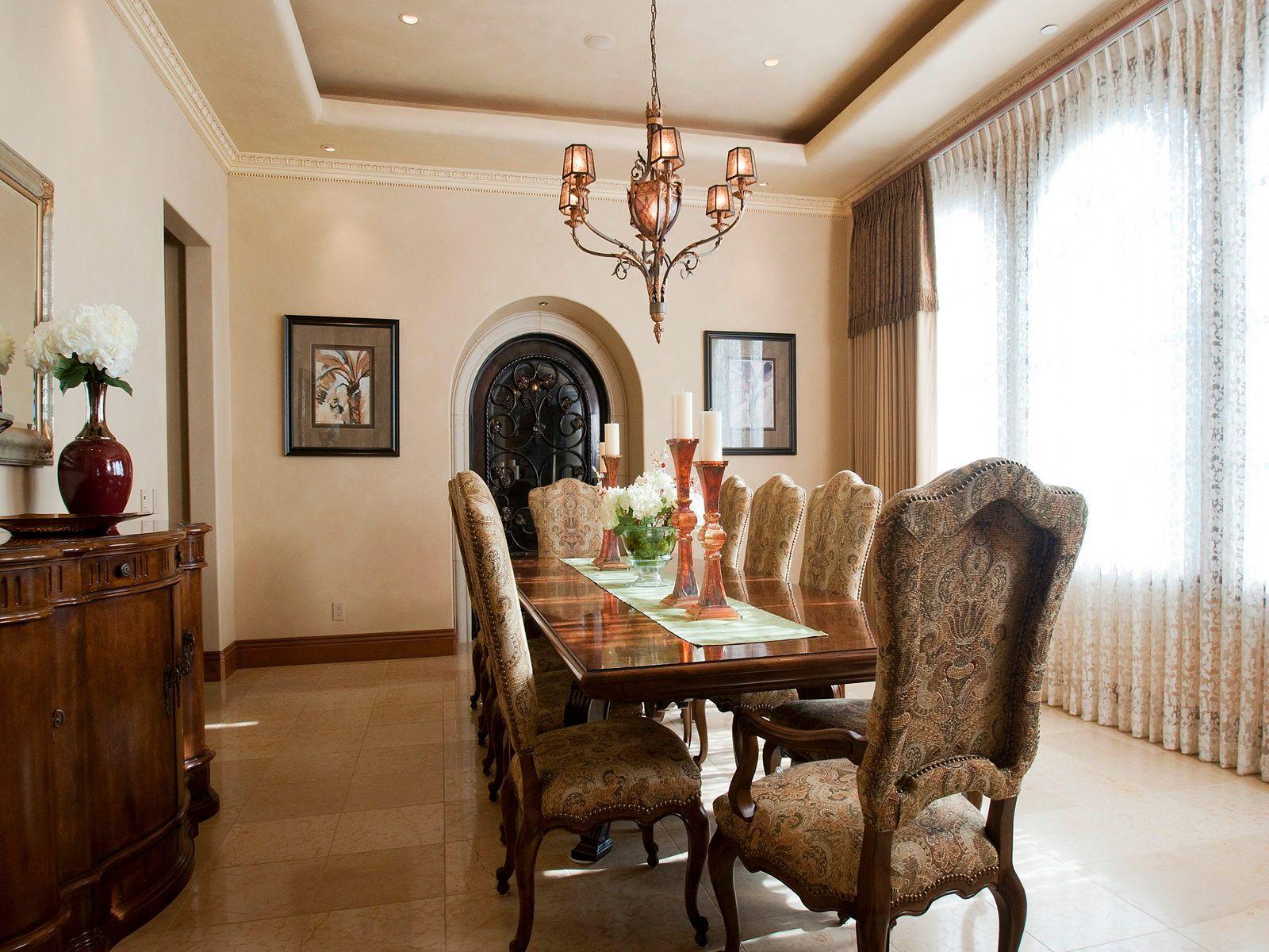 Dining room features Fine Art chandelier