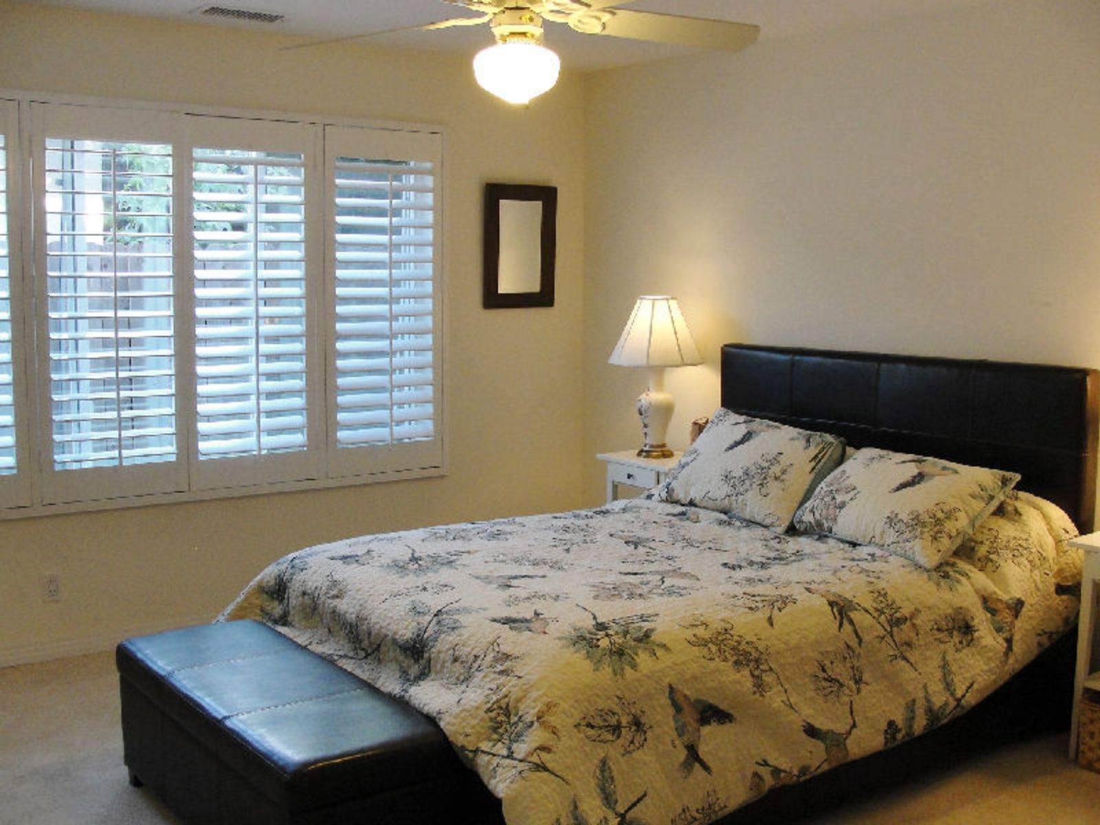 Master suite with plantation shutters.