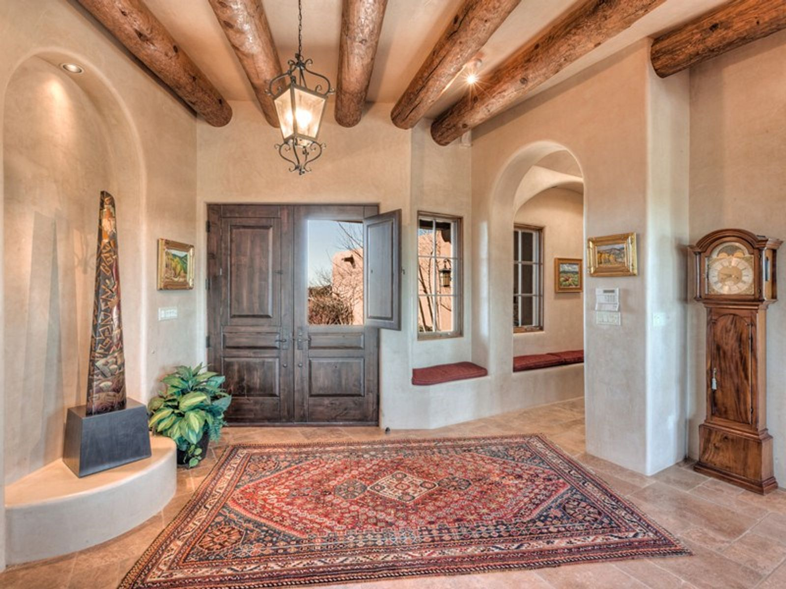 Entry-tall ceiling, graceful arches, art nichos