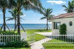 Beachfront Cabana with lush lawn and white sandy beach